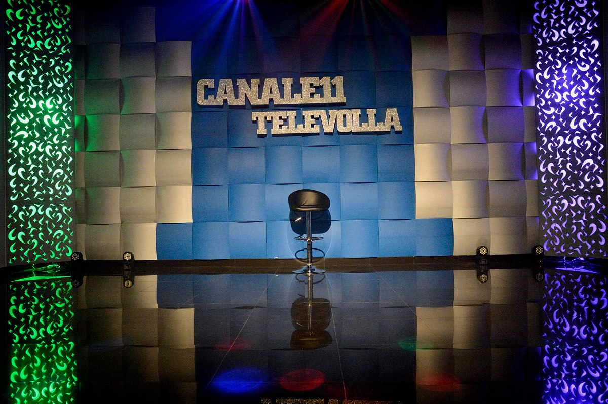 Televolla, one of the numerous TV stations entirely consecrated to neomelodica music. Wanting to promote themselves as live performers at private parties, singers pay to appear on TV shows. Neomelodici gain most money from performances at birthdays, communions, marriages and other private parties.
