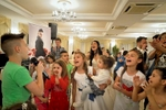 Sasà (11) sings at a wedding in a banquet hall in Trecase, at the foot of Mount Vesuvius. At a wedding it is not rare to have a succession of both adult and child singers.