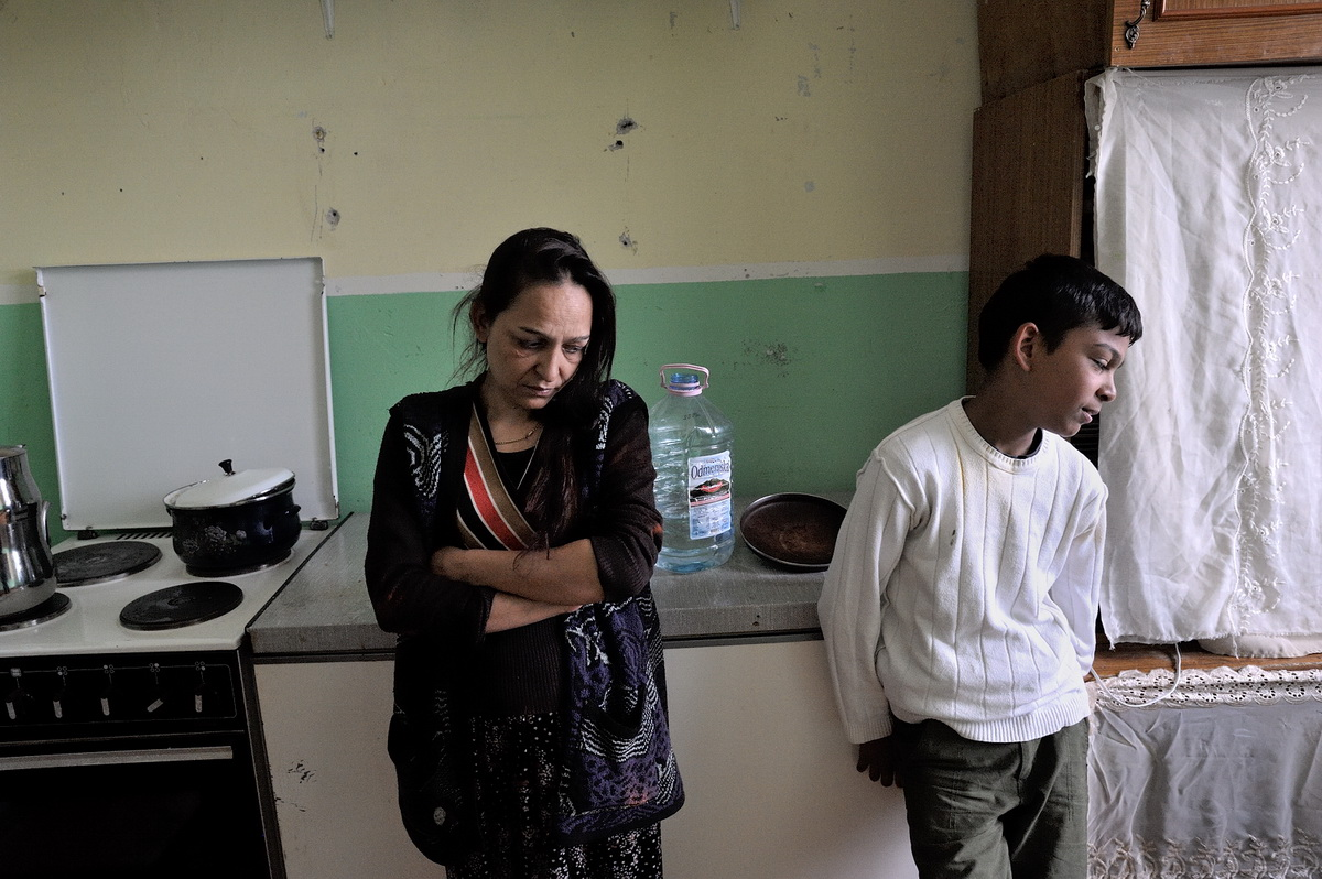 Suzana Jahitovic and her son Mevruz in the kitchen of their home in Osterode camp in northern Mitrovica. Before being expelled in 2005, the Jahitovic family lived for 16 years in Germany.
