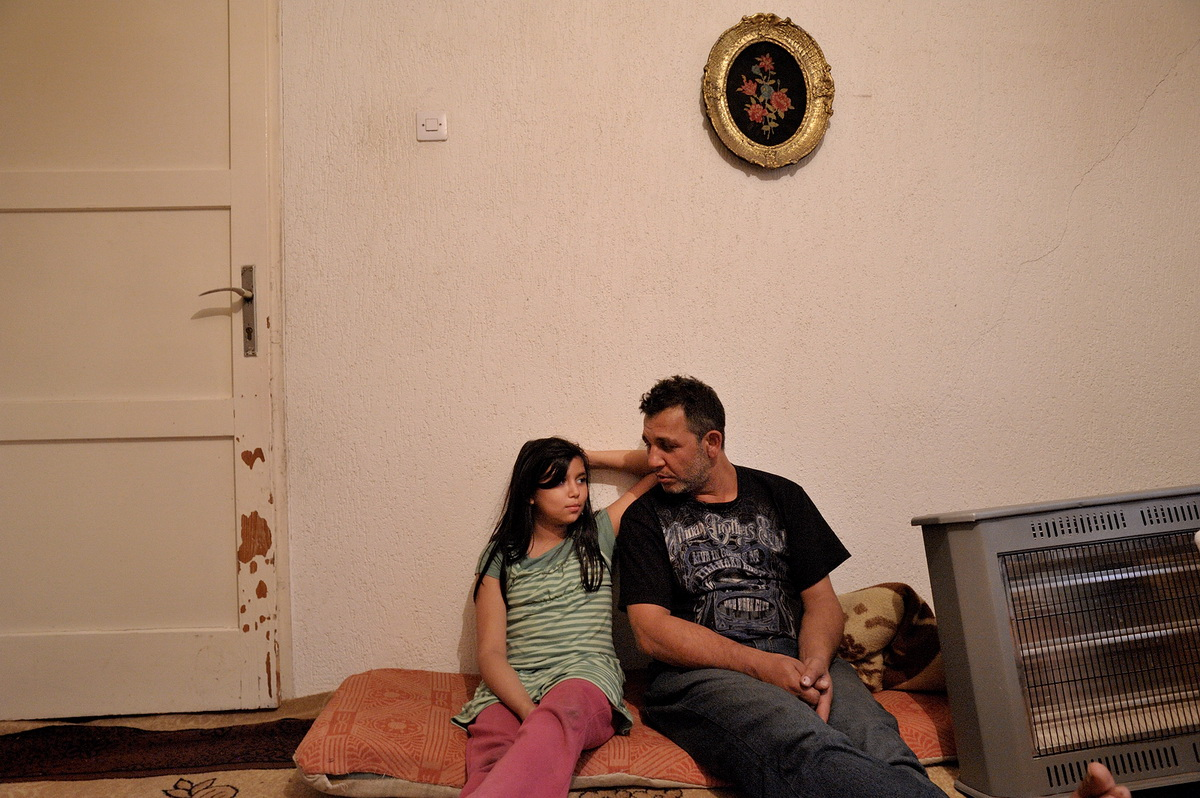 Florim Mujolli and his daughter Nadira. The Mujolli's were expelled after having lived twenty years in Germany. All of the six children were born over there.