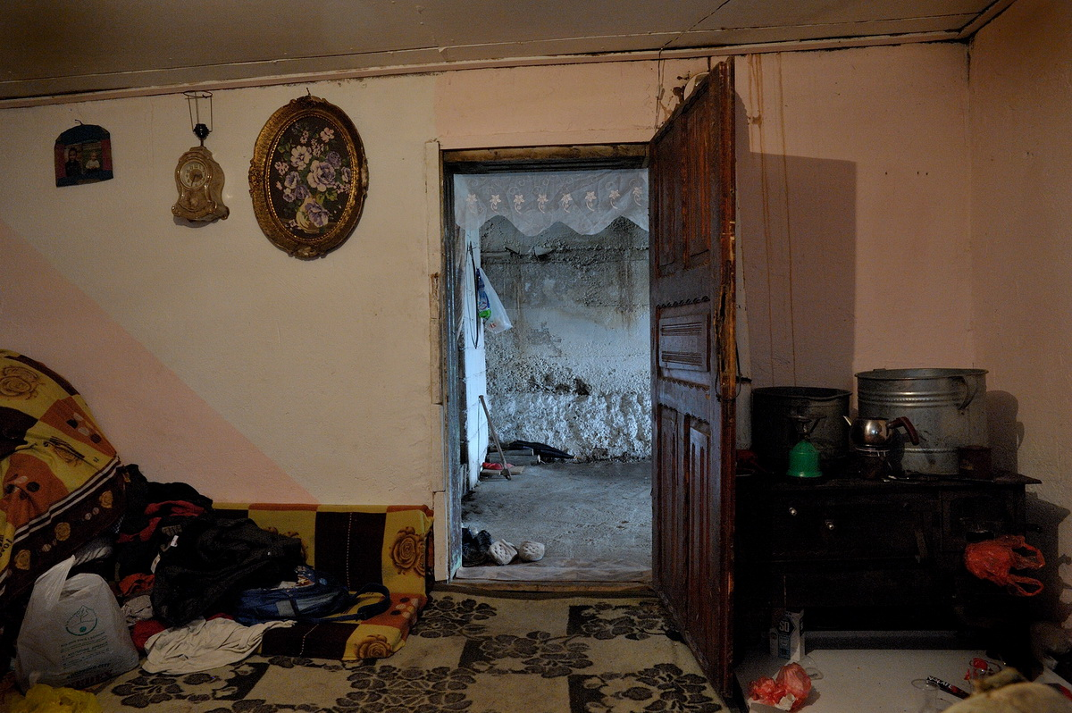 The damp basement room in the mahalla Botes/Shtatore in Peja, where the five members of the Haxhija family live.