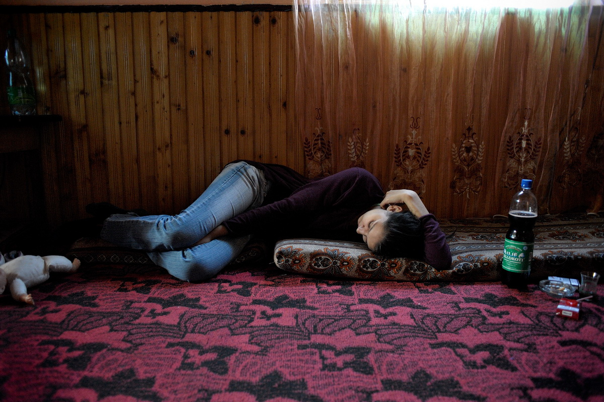 Nermina takes a nap in her home in Fushe Kosovo. Seventeen-year-old Nermina was born in Germany and lived there her whole live before being expelled in 2010. She wanted to be a nurse but can't continue her education in Kosovo.