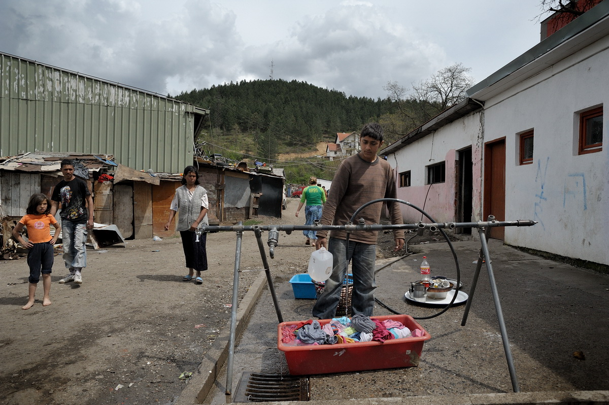 Leposavic camp in northern Kosovo used to be a storage for tanks of the Yugoslav army. Now it houses Roma families who were internally displaced in the war. Upon their return from Germany, the Hasani family had nowhere to stay and now lives with stepfamily in a small unit.