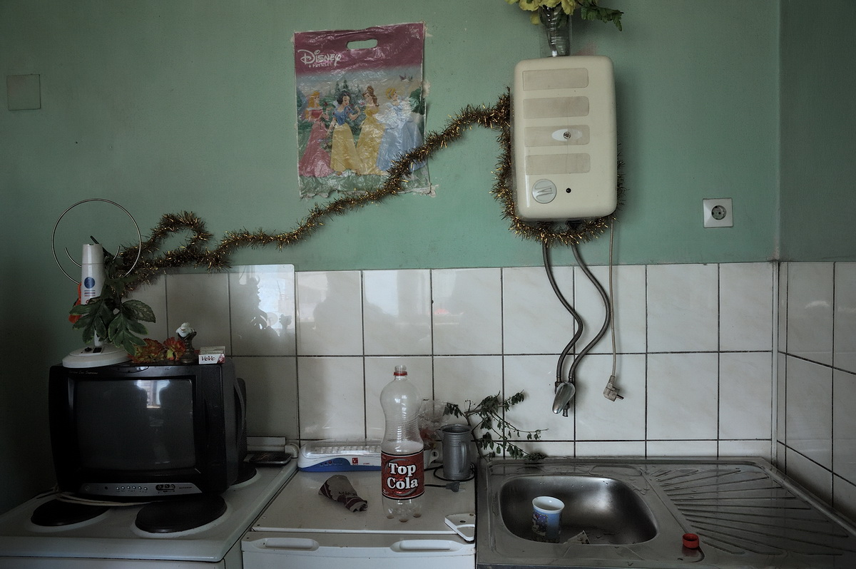 The kitchen in the one room apartment of the Sahitoviq family in Obiliq. Since the beginning of 2011 the family no longer has electricity.