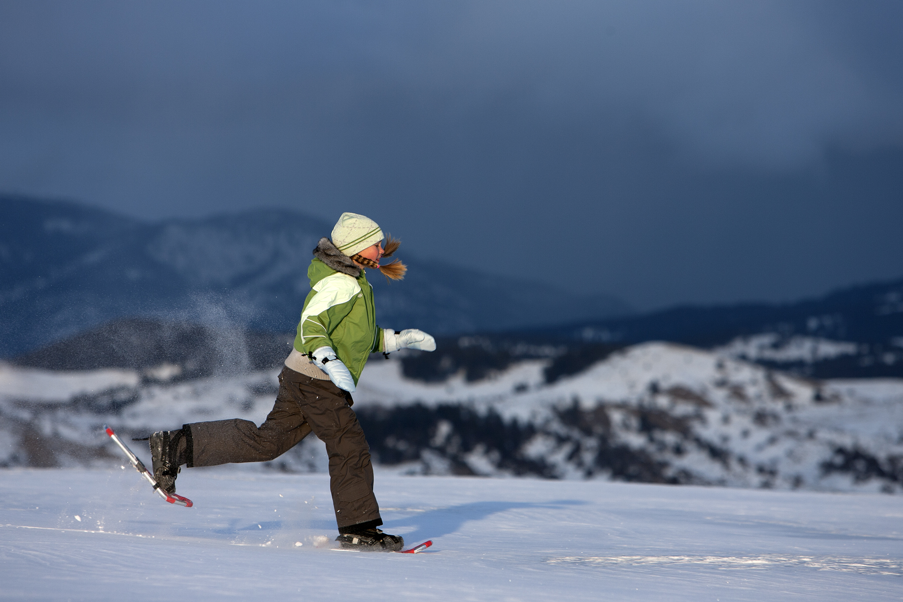 Girl(9 years old) snowshoeing in Bozeman, Montana.