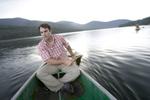 Kristoffer Erickson canoeing on Hylite Lake Resevoir. Hylite Canyon, Montana.