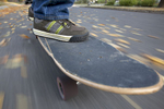 Man_Skateboarding_POV_feet