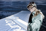 Portraits of Erika Skogg with her snowboard on a frozen Canyon Ferry Lake near Townsend, Montana
