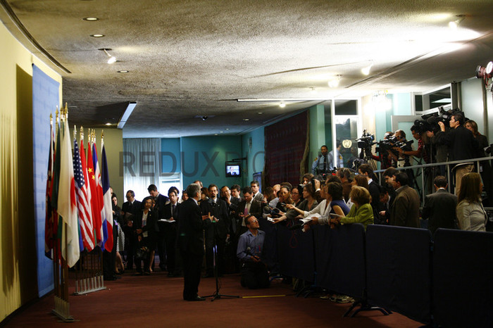The media gather around a diplomat during a press conference at the United Nations Headquarters.