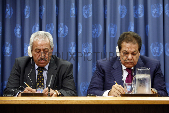 Unidentified diplomats make notations during General Assembly proceedings