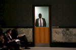 A documents officer stands in the doorway at the United Nations Security Council.