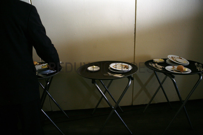 Food trays piled high with dishes at the United Nations Headquarters.