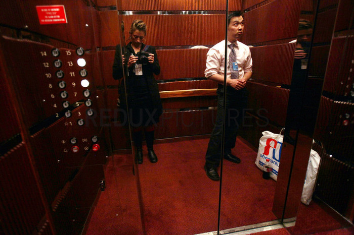 The photographer is pictured in a reflection of an elevator at the United Nations General Assembly.