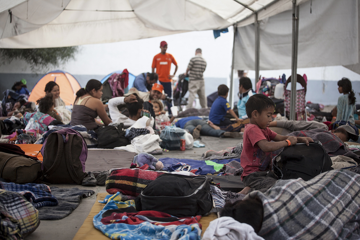 In the Mexican border city of Tijuana, thousands of Central American migrants traveling together in an exodus known as the {quote}Caravan{quote} continued arriving in the city November 15, 2018. Here, migrants rest in the temporary shelter operated by the Mexican government at the Unidad Deportiva Benito Juárez sports center.