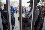 In the Mexican border city of Tijuana, thousands of Central American migrants traveling together in an exodus known as the {quote}Caravan{quote} continued arriving in the city November 15, 2018. Here, migrants wait to enter the enclosed area in the temporary shelter operated by the Mexican government at the Unidad Deportiva Benito Juárez sports center.