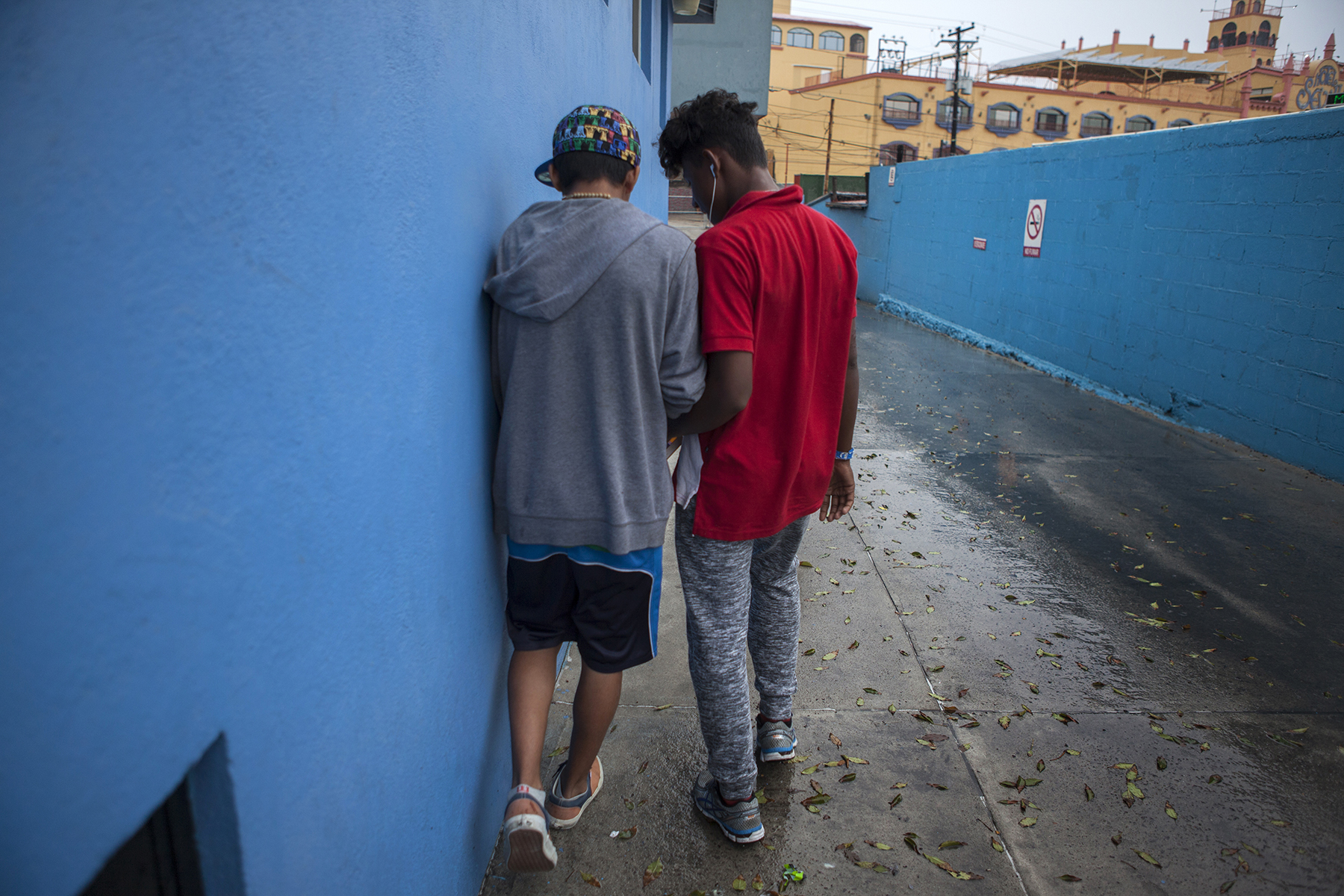 Unaccompanied child and teenage migrants like Vladi from El Salvador, shown here (L), stay in Tijuana, Mexico's only shelter for minors on November 29, 2018. CREDIT: Erin Siegal McIntyre for Frontline