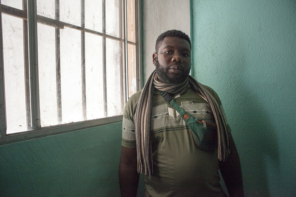 Tangie Sule was tortured by police and left for dead in his native Cameroon. {quote}I did not decide to leave, but I had to,{quote} he said June 27, 2019 in Tijuana. {quote}My life was at risk.{quote} His brother was shot before him, and he fled without his wife and one-year-old daughter. Like thousands of other asylum-seekers in the border city, he plans to request asylum from the United States. Sule trekked on foot from Ecuador with a group of around 50 Cameroonians, crossing the Darien gap. Cameroon is on the brink of civil war, with English-speaking secessionists known as {quote}Amba Boys{quote} attempting to break away to form a new state, Ambazonia. The government forces of Cameroon, trained by U.S. and Israel, are accused of perpetrating widespread human rights abuses. Tens of thousands of English speakers have fled.{quote}Others died on the way,{quote} Sule recounted. {quote}They got swept away from the rivers in the jungle. Snake bites. There's nothing you can do. The only thing you can do is help yourself.{quote}