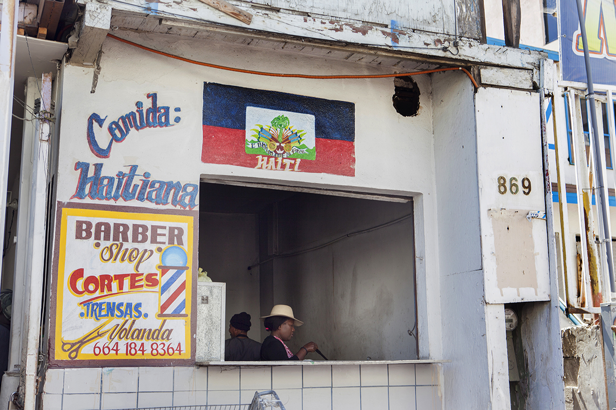A Haitian restaurant is shown in Tijuana on June 27, 2019. After U.S. President Barack Obama ended humanitarian parole for Haitians, many Haitian migrants settled in Tijuana and traded in their hopes of living the {quote}American dream{quote} for a {quote}Mexican dream.{quote}