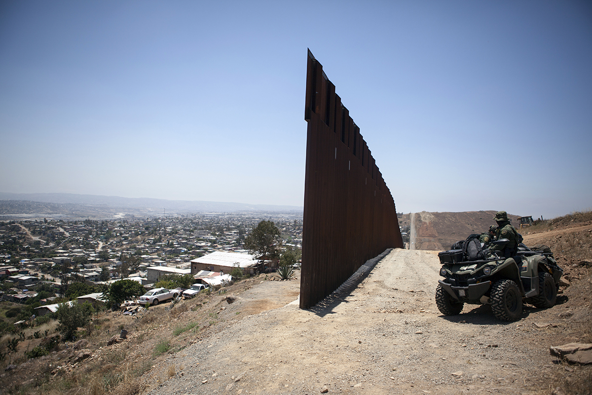 The end of the westernmost  section of U.S- Mexico border wall is shown from the neighborhood of Nido de Las Águilas, Tijuana on June 27, 2019. It is monitored around-the-clock by U.S. agents on ATVs.