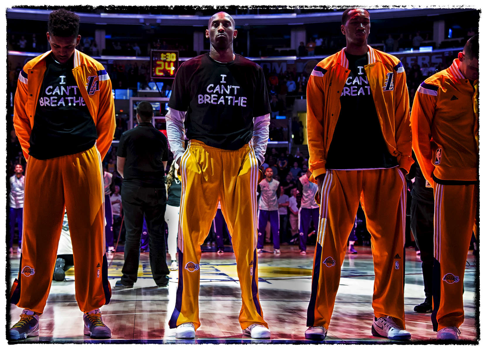 {quote}I Can't Breath{quote} - This image is a very powerful one to me. You see two other teammates {quote}pushing{quote} the NBA dresscode policey to make a statement. Kobe had no fear and boldly let the world see his stance. Before players took a knee, Kobe with help from Nike, used his platform for those who did not have one.