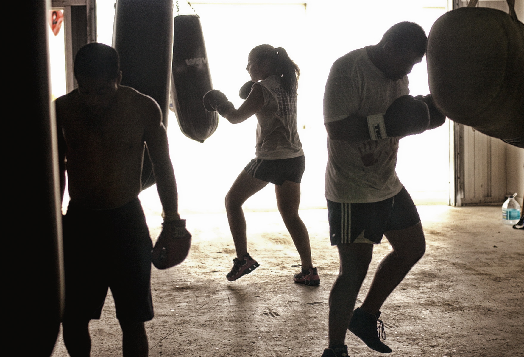 Photo 1 of 3.  Kaleigh Patri (center) (cq), 14, of New Port Richey started boxing at Magnum Boxing in Holiday in early June after eight years of figure skating because she wanted something more aggressive.  Although some of her male friends have told her that there is no girls crazy enough to fight at 14-years-old, Kaleigh says {quote}I just like getting my aggression out and I like guy dominated sports.{quote}   Description Feature picture, story, at Magnum Boxing in Holiday. Focus is on Kaleigh Patri, 14, of New Port Richey.