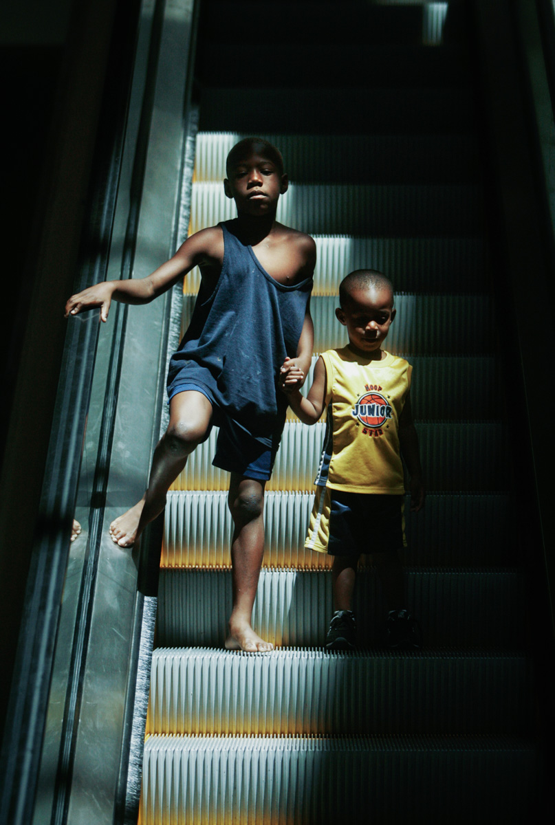 Baton Rouge 9/6/05 From left, Vincent Phillips (cq), 2, and his nephew Koymani Umine (cq), 2, descend the escalator at an evacuee shelter in Baton Rouge, La. Tuesday, September 6 2005.   Approximately 500 children are being housed at the shelter.Globe Photo/Erik JacobsSlug:Reporter: Raja Mishra