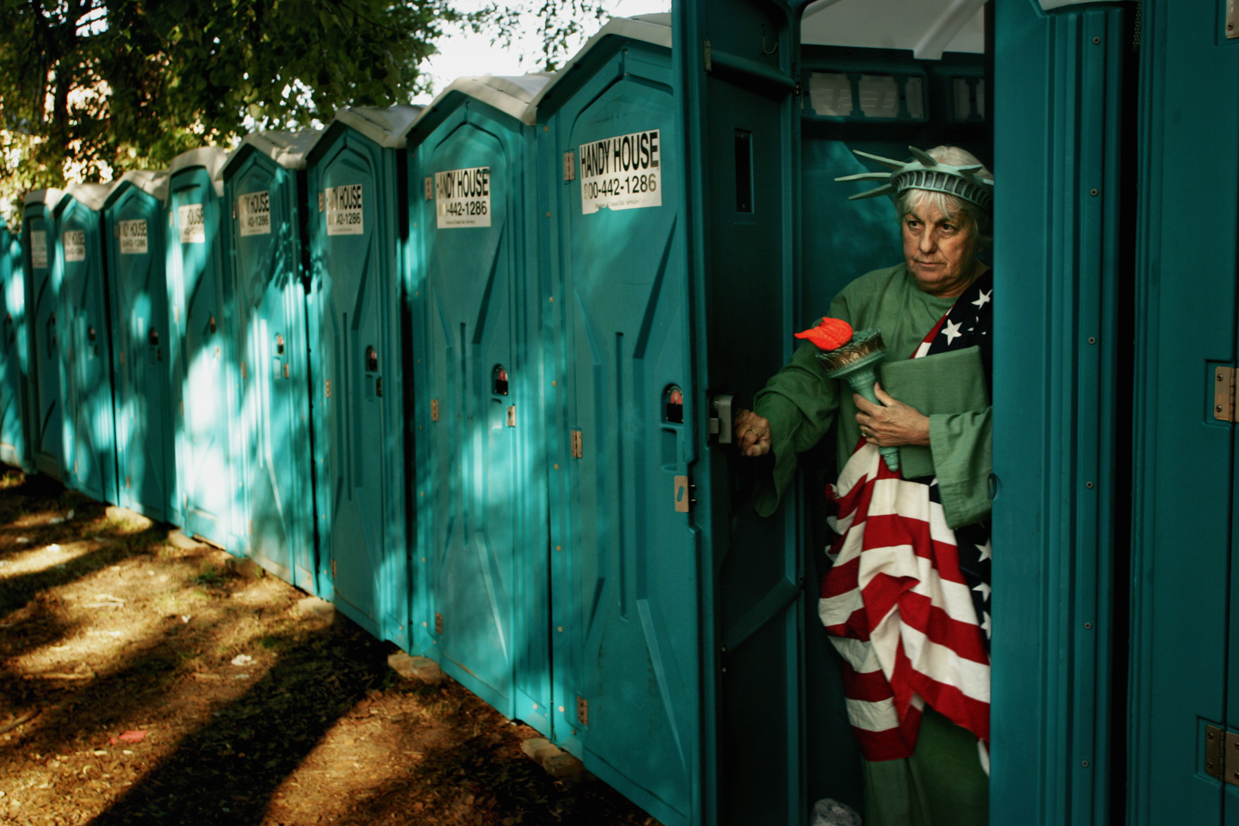 7/4/05 -- Boston -- Carol Hunt (cq) (dressed as lady liberty), of Milton leaves a Handy House before the Boston Pops Concert at the Hatch Shell in Boston.  {quote}Hey, everybody's got to go.  Even us,{quote} Hunt said referring to a few of her friends dressed in costume for the concert.  Photo by Erik Jacobs/Glove Photo
