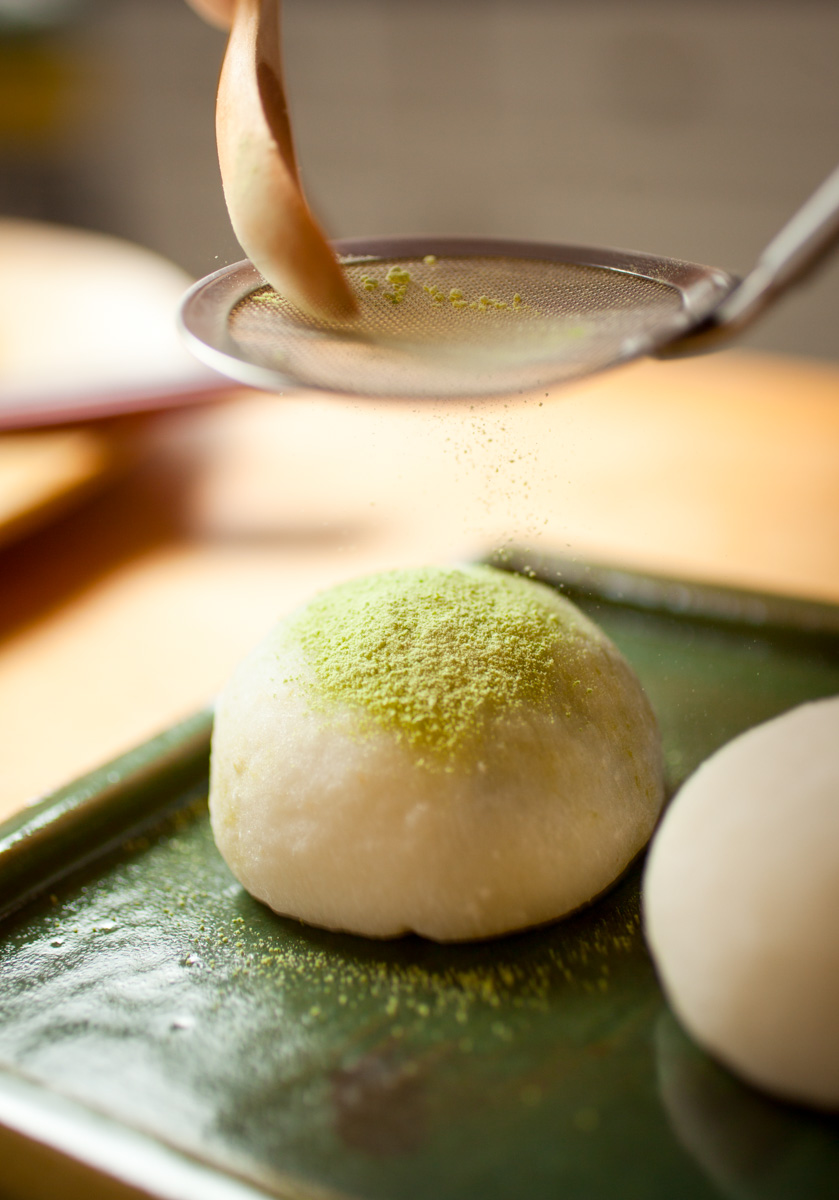 5/24/12 Somerville, MA -- Erino Wade, owner of Mochi Kitchen, uses match powered to top a red bean filled green tea mochi May 24, 2012.  Erik Jacobs for the Boston Globe