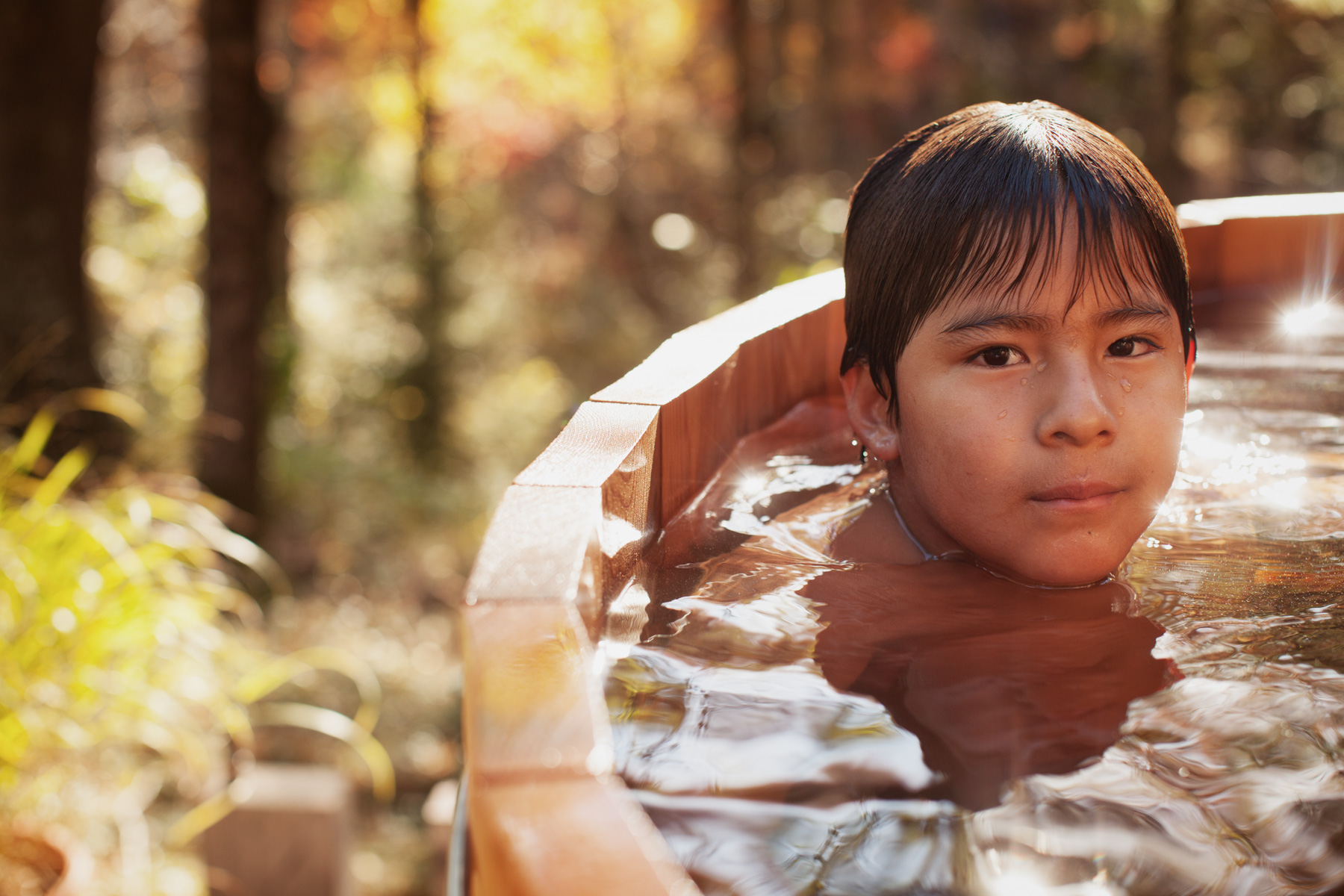 10/11/10 Phillipston, MA -- Mateo Gold, 7, soaks in the warmth of his family's wood-fired hot tub at home in Phillipston, Mass. Oct. 11, 2010.  Erik Jacobs for the New York Times