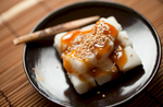 5/24/12 Somerville, MA -- A photo of Mitarashi, which is mochi  covered with a sweet soy sauce glaze and sesame seeds May 24, 2012.  Erik Jacobs for the Boston Globe