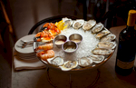 7/19/10 Boston, MA -- An assortment of oysters, crab claws and shrimp from Neptune Oyster's raw bar in Boston July 19, 2010.  Erik Jacobs for the New York Times