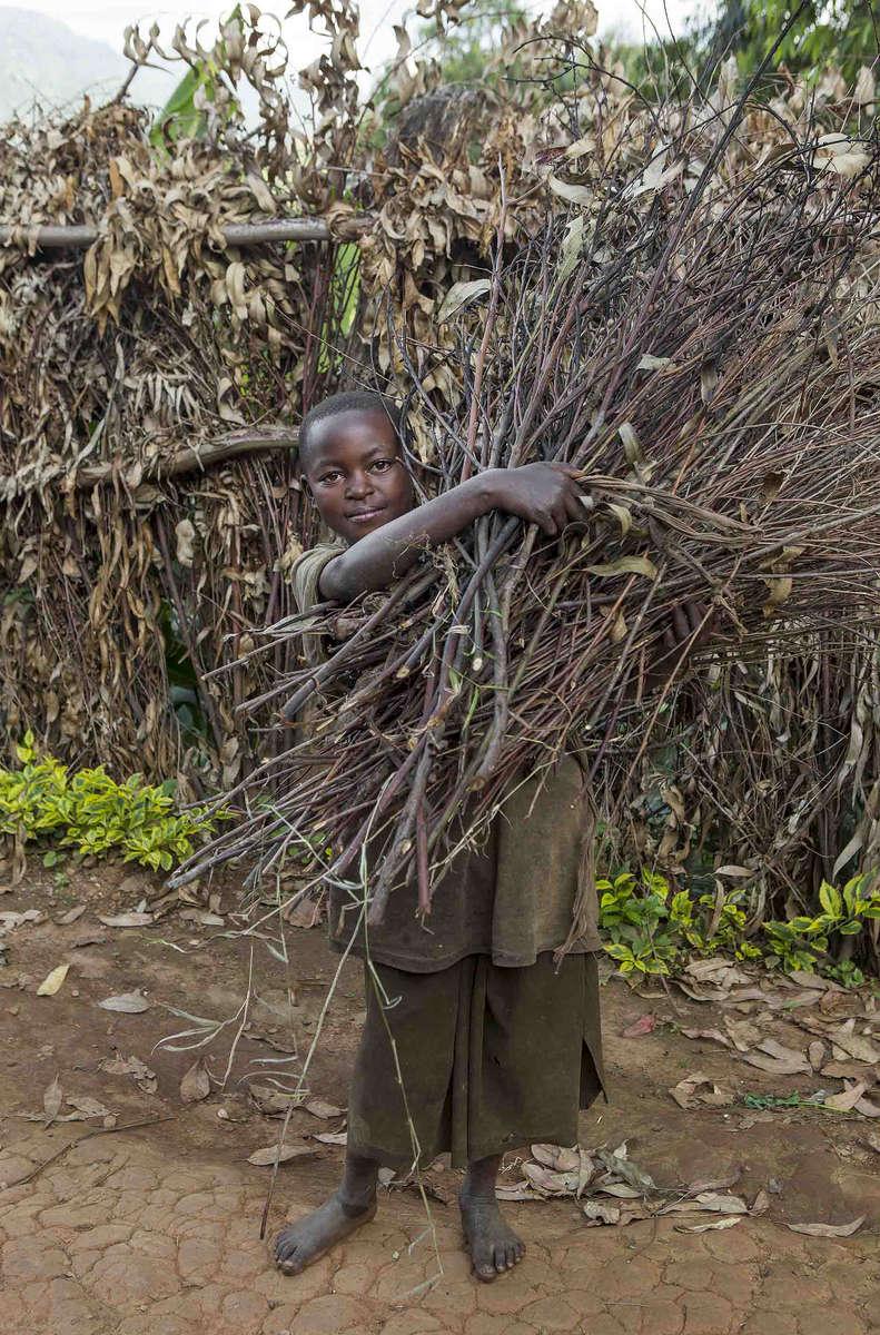 Girl collecting sticks, Rwanda