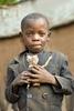 Batwa boy with a toy, Rwanda