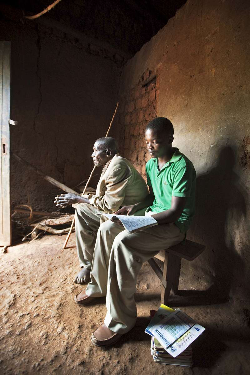 Student at home with his grandfather, Rwanda