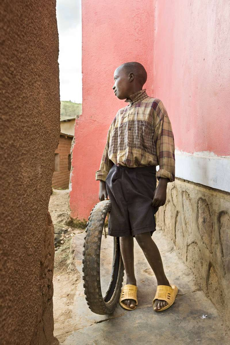 Boy with tire toy, Rwanda