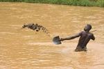 Digging sand in the Nyabarongo river, Rwanda