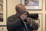 Doug Palmer, photographer and Clerk of the Court, EDNY,  shoots photos at the opening.Photo: © Rick Kopstein