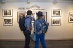 Attendees view the exhibit.Photo: © Rick Kopstein