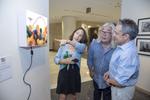 Photographers, Lauren Welles and Ken Shung, with exhibit Installation, designer Dan Schnur.Photo: © Rick Kopstein