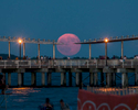 Full Moon Over the Coney Island Pier, July 9, 2017  © John Huntington