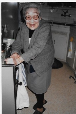 "Elaine Murata Sunoo, guest contributorMy Grandma played a major role in our family throughout our lives.  One of many memories is Grandma in the kitchen.  She owned the kitchen!After World War II, as Japanese-American families began their resettlement after leaving the internment camps, it was not uncommon to have multi-generations living together under the same roof.   I felt only comfort and security that my widowed grandmother, my father, mother, and older brother by six years all lived together.  During those years, my mother, who loved to cook, enjoyed having extended family and friends over for a meal at a moment's notice.  But, life changed in an instant for us when my mother died very unexpectedly.  She was 40 years young, I was 10 years young, and Grandma was 66 years old!   She stepped into our kitchen and feeding the family became her responsibility and the kitchen became her domain.I loved her cooking!  I loved the Japanese meals she prepared:  Rice, tsukemono, varieties of fish, vegetables.  On special occasions, she would make maki sushi and inari sushi.    Every Boy's Day, she would roll sushi which she would share with the aunties/uncles/cousins and close friends.  Every Girl's Day, she would prepare (everything from scratch) sweet manju and again would share with many of us.But, cooking was sometimes challenging as she tried to please her two young grandchildren.  I learned many years later, that Grandma asked her daughters to teach her how to make a few standard ""American"" meals for us.One day, as a high school student, I came home upset that as part of our club's big potluck dinner event, several of us were asked to prepare and bring a casserole.  I had only a very vague idea what a casserole was – and no clue how to prepare one . . . and I assumed Grandma was even more clueless than I.   Turning to my brother, I explained my dilemma.  Before I knew it, I was in tears, feeling sad that  ""If I had a mother . . . .  ""Well, to my surprise, he suggested a do-able solution:  Grandma, he reminded me, makes spaghetti using Lawry's packaged spaghetti sauce.  ""Just cook some hamburger and onions, add the packaged mix and a can of tomato paste and water.  Then, mix it together with cooked spaghetti noodles. Grate cheese over it all . . . throw it into the oven!   That's it!""On the evening of the event, the casserole turned out fine. I proudly took it to the potluck dinner.  But, I realized that I much preferred Grandma's comfort food to the assortment of casseroles on the buffet table . . . and I came to appreciate her endless efforts to feed and please us. Grandma died in her sleep peacefully in 1990 at age 98, after hosting a large family dinner two days earlier. She amazingly prepared some of her specialties!  I know it was her way of saying good-bye to us all!And now, as a 70-year-old daughter and grandmother, I am cooking my grandma's Japanese comfort food for my 101-year-old father. Elaine Murata Sunoo is the childhood friend and sister-in-law of JejuGranny. (In November, Elaine's father, Tetsuo Murata, passed away peacefully and quietly in his home in Los Angeles, California.)Photo of Hisayo Inouye Murata – 81 years oldTo learn how to make some Japanese comfort food, view:https://www.foodandwine.com/blogs/9-japanese-comfort-foods-make-right-now"