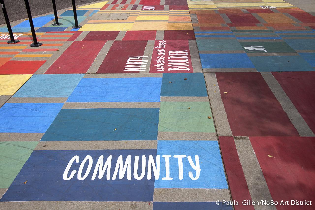 A detail of artist Joyce Robinson's painted sidewalk mural on Broadway Streetm Boulder, CO. Sept. 2015.