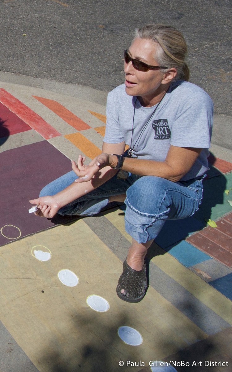 This photo shows Lisa Nesmith - president of the NoBo Art District assisting Joyce Robinson with some final painting. October 2015