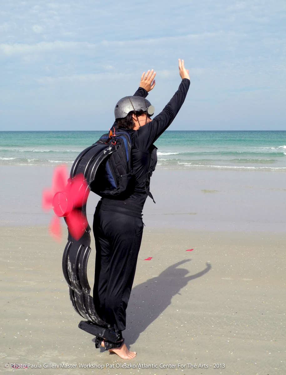 Associate Artist Maria del Carmen Cachin performing on the beach during the performance of Darwin's