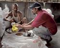 Rabi venant chercher la ration de nourriture pour sa famille. Chaque 15 jours les réfugiés viennent chercher les rations de nourriture distribuées par le World Food Programme (WFP). Cela comprend du riz, du sel, de l'huile, des lentilles, quelques légumes et des céréales. Népal, 2009.