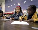 Bidhya est rentrée à  l'école 15 jours après leur arrivée à Dallas. Elle est dans une classe de remise à niveau avec d'autres réfugiés venus de part le monde ( Somalie, Irak, Erythrée...) Texas, Etats-Unis, 2009.