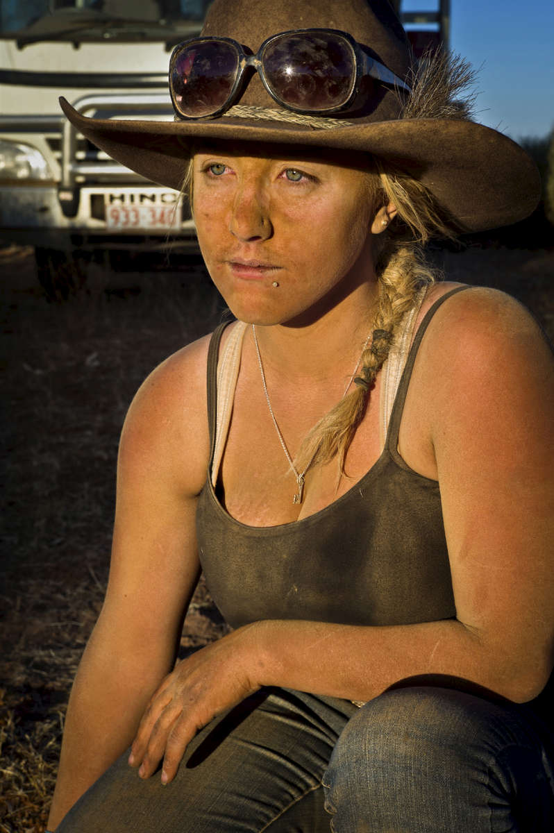 22-year-old Cassandra is one of only two women who are part of the mustering team. The workers get free meals and accommodation and are paid between a$600 and a$800 per week. 2011, Northern Territory, Australia.