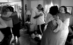 Family members hug with friends after Pat's service.