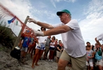 South Carolina United Turtle Enthusiasts (SCUTE), area coordinator Phil Schneider removes a protective fencing before a nest inventory on Pawleys Island, South Carolina August 10, 2012. According to SCUTE, 70% of the eggs hatch and go out to sea where their organization and their volunteers work. The number one predator to the eggs are ghost crabs.REUTERS/Randall Hill
