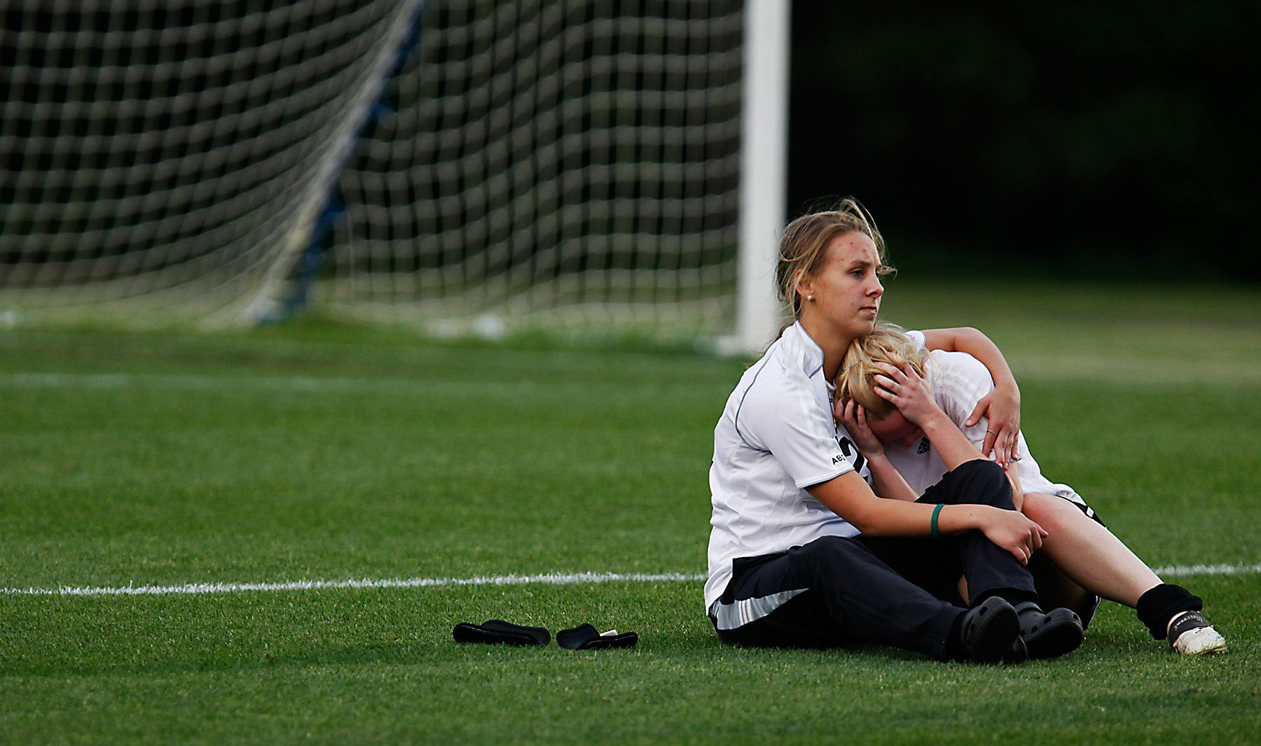 Waccamaw girl's soccer player Abby Weimer,12, (left) consoles teammate Callie Dennis, 11, after the Warriors lost 1-0 to Bishop England High School in the Lower State Championship game held at Waccamaw.